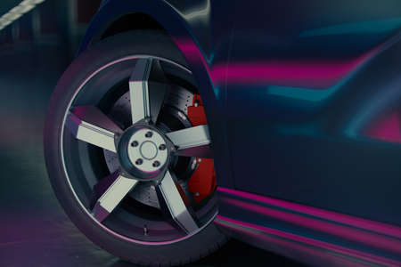 Modern car in the garage with violet (blue - magenta) studio lighting. Close up view on a front wheel of a modern sports car. 3d illustration.