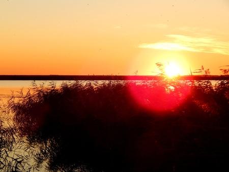 Beautiful sunset on a fresh lake near Yarovoy