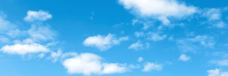 Blue summer sky with cumulus white clouds. Low angle shot. Banner for website. Banco de Imagens