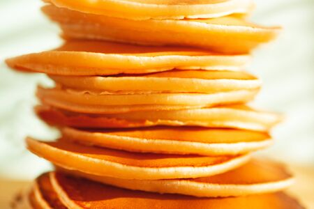 Stack of tasty home cooked pancakes. Close-up. Soft selective focus.