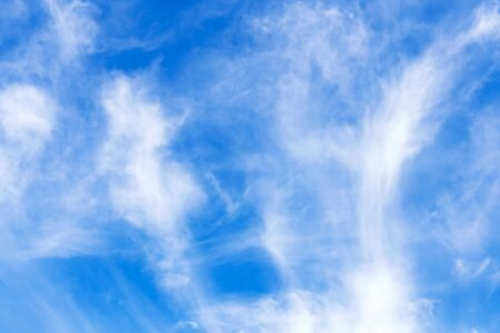 Beautiful abstract background. Blue summer sky with white clouds. Natural colors.