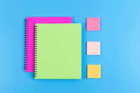 Back to school concept. Colorful stationery on blue background. Copy space.