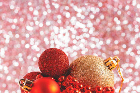 New Year baubles and garland against glitter pink bokeh background. Close-up. Soft selective focus. Banco de Imagens