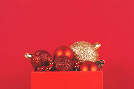 Box of Christmas ornament on red