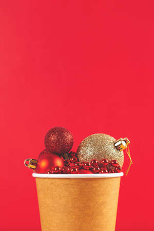 Cardboard cup of Christmas ornament on red