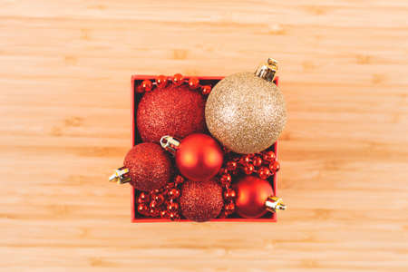 Square box with Christmas tree decorations. Top view