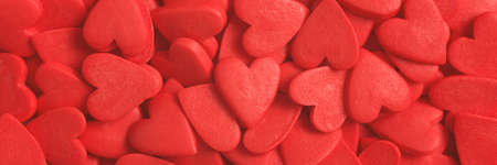 Texture of red sweet hearts. Close up. Banner for website. Banco de Imagens
