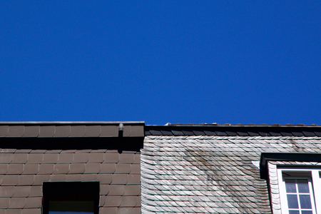 housetop: Different styles of roof tiles made of slate on a housetop in Germany