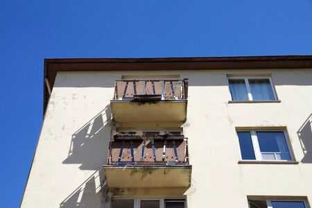 Apartment house with balconies against a blue sky in Aachen, Germany