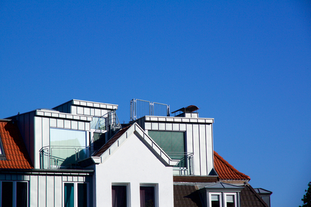 Close-up view on a new construction apartment with dormer windows Stock Photo - 78451787