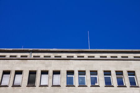 Windows of a office building against a blue sky