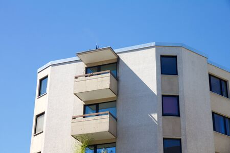View on apartment building with balcony against a blue sky Stock Photo