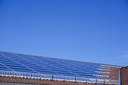 Photovoltaic panels on the roof of a supermarket with copyspace Stock Photo - 91967850