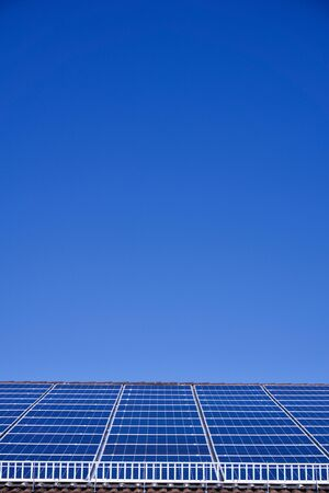 Photovoltaic panels on the roof of a supermarket with copyspace Stock Photo - 91942809