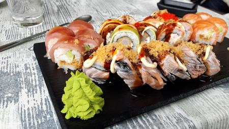 Japanese sushi set on the wooden background.