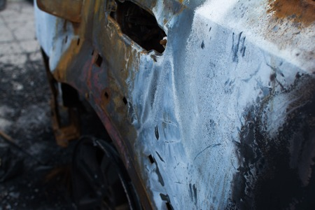 totaled: An abandoned, stolen burnt out car.