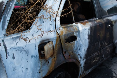 insurrection: An abandoned, stolen burnt out car. Full HD photo.