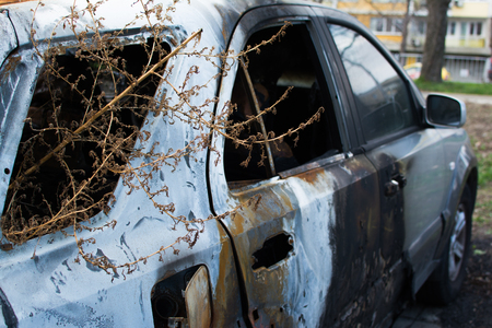 abandoned: An abandoned, stolen burnt out car. Full HD photo.