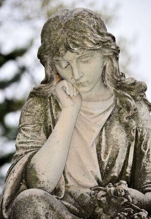 angel headstone: Angel statue found in cemetery