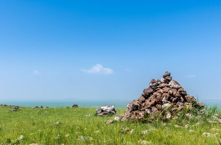 rock pile: rock pile on the meadow Stock Photo