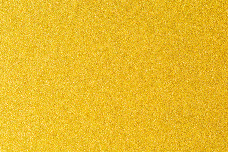 details of golden texture background gold color paint wall stock