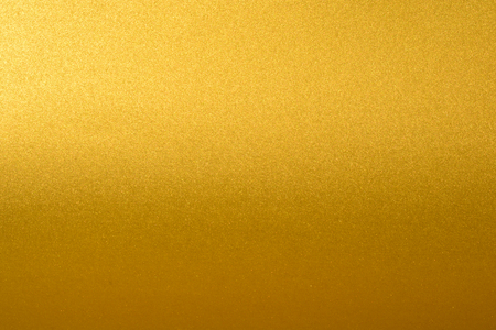 Details of golden texture background with gradient and shadow. Gold color paint wall. Luxury golden background and wallpaper. Gold foil or wrapping paper. Stock Photo