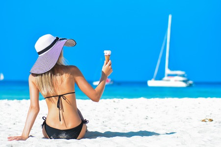 Girl on the beach. Travel vacation concept. Young woman with tanned sexy body. Tropical island
