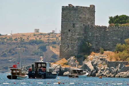 sailingboat: Detail of castle in Bodrum with boats