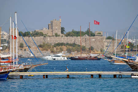 sailingboat: Castle in Bodrum with harbour Editorial