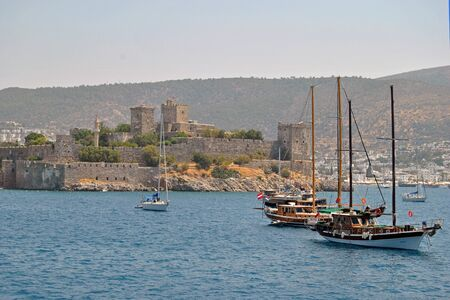 sailingboat: Castle in Bodrum with sailingboats Editorial