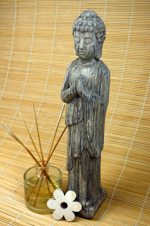 Buddha with smell sticks and flower