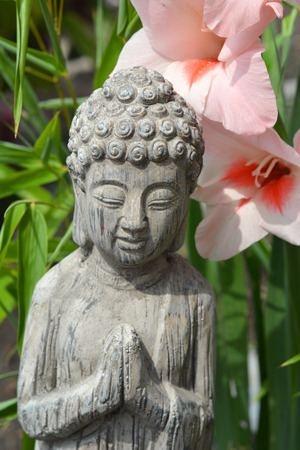 anthracite coal: Buddha with  flowers and bamboo