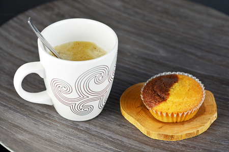 Nice warm cup of coffee, with muffin photo