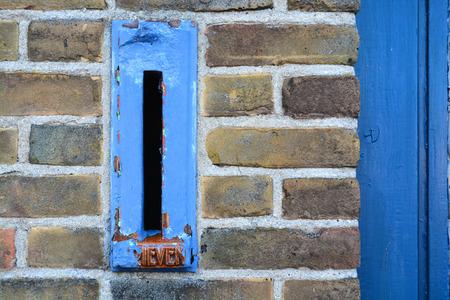 Antique blue mailbox photo