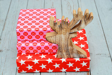 nice christmas gifts with reindeer of wood stock photo picture and royalty free image image 34122428 - Nice Christmas Gifts
