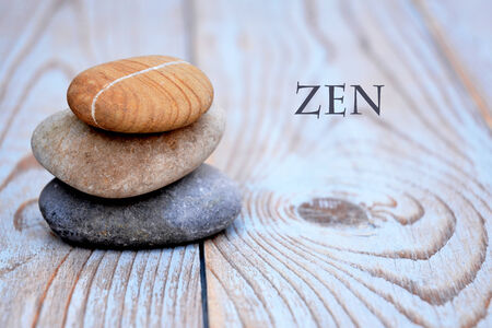 head stones: Three zen stones on old wood decorated