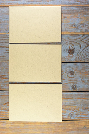 passe: empty pieces of paper on old wood background Stock Photo