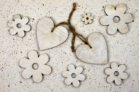 entwined: Natural love decoration with, wooden harts Stock Photo
