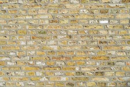 forground: old yellow bricks wall with empty copy space
