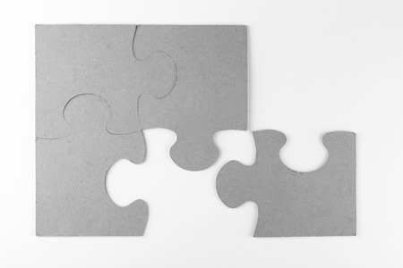 White copyspace empty gray background with gray puzzle pieces 스톡 콘텐츠