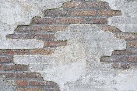 damaged cement: detail of a old broken cement damaged brick wall and empty copyspace