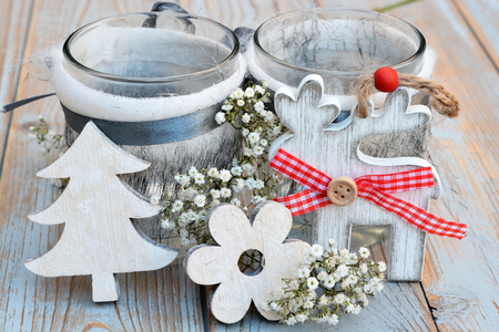 babys: Old wooden shelves gray with red white wooden Christmas decoration like star, heart, tree reindeer and candles holder decorated with babys breath flowers Stock Photo