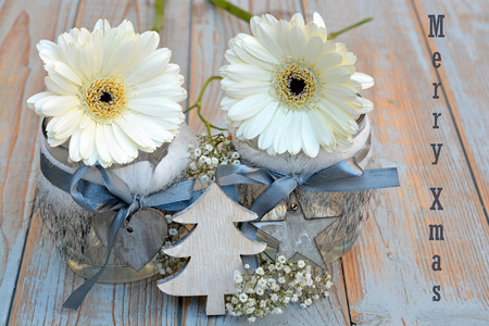 red gerber daisy: Old wooden shelves gray with red white wooden Christmas decoration like star, heart, tree gerber daisy and candles holder decorated with babys breath flowers