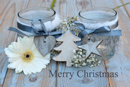 curios: Old wooden shelves gray with red white wooden Christmas decoration like star, heart, gerber daisy and candles holder decorated with babys breath flowers