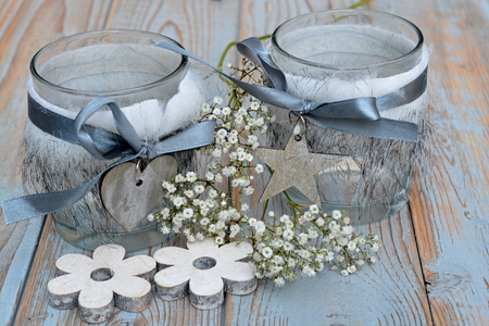 babys: Old wooden shelves gray with red white wooden Christmas decoration like star, heart and candles holder decorated with babys breath flowers