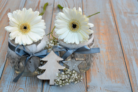 red gerber daisy: Old wooden shelves gray with red white wooden Christmas decoration like star, heart, gerber daisy and candles holder decorated with babys breath flowers