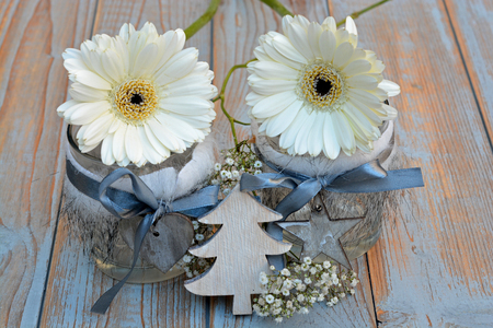 gerber daisy: Old wooden shelves gray with red white wooden Christmas decoration like star, heart, tree, gerber daisy and candles holder decorated with babys breath flowers Stock Photo