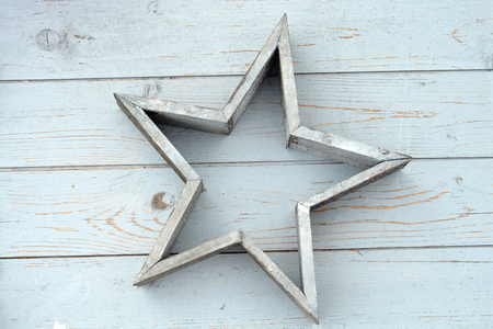 christmas decor: Old wooden shelves gray with gray white wooden Christmas decoration star Stock Photo