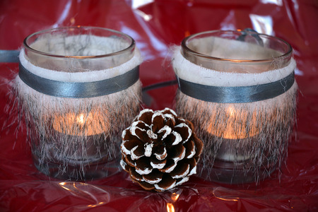 tea candle: red shiny glitter christmas background with gray decoration and tea candle lights Stock Photo