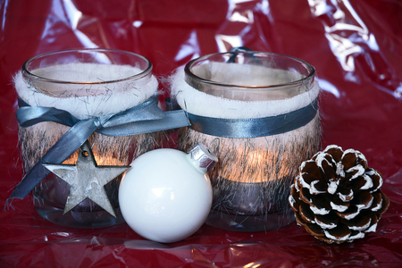tea candle: red shiny glitter christmas background with gray wooden star decoration and tea candle lights Stock Photo